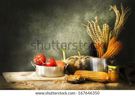 still life making a cake with pumpkin,corn and grain - stock photo
