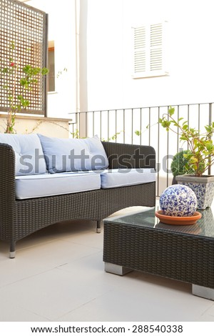 Still life of a home outdoors living room and terrace garden outdoors eating area with table and chairs, in a stylish graphic house, relaxing area. Home living, empty space, aspirational lifestyle. - stock photo