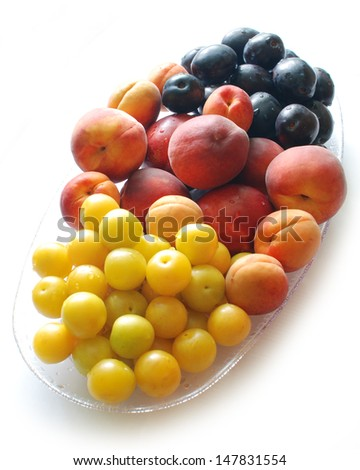 Still life of apricots peaches plums cherry-plums - stock photo