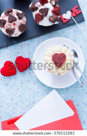 Still-life of beautiful cupcakes and romantic envelope on decorated background.From above