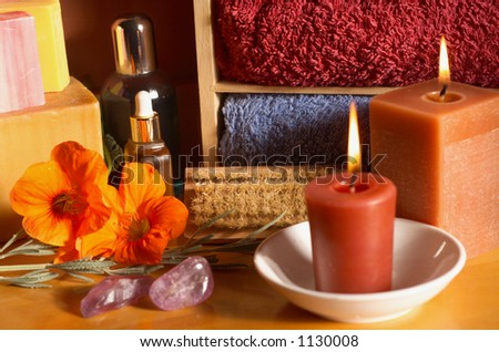 Still life of beauty treatment items with Aromatherapy Candles, Crystals and Soaps