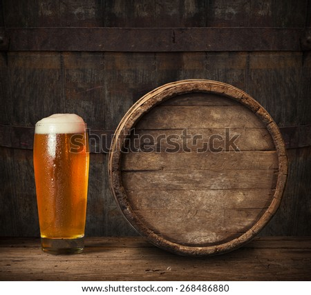 Still Life of beer and barrel on a grange background - stock photo