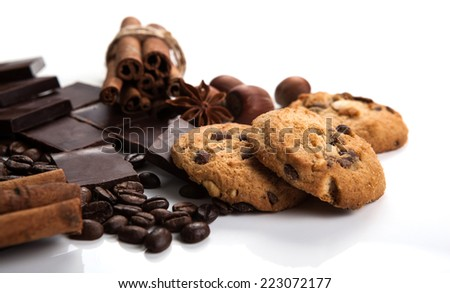 still life of biscuits and chocolate on a white