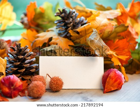 Still Life of Blank Place Card Amongst Autumn Foliage - stock photo