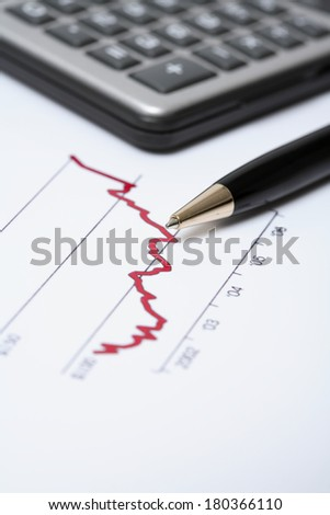 still life of budget stats and calculator  - stock photo