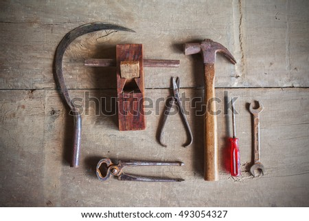 Still life of carpenter craftsman tools kit on wooden background