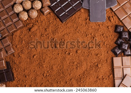 still life of chocolate in cocoa - stock photo