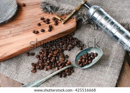 still life of coffee beans on  jute bag with coffee grinder