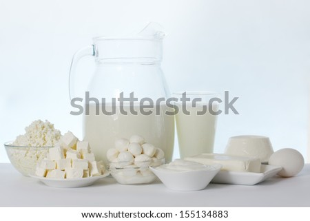 still life of dairy products and soft cheese varieties
