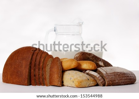 still life of different types of bread and milk - stock photo