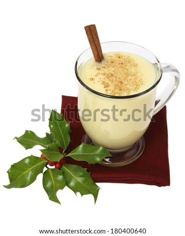 Still life of eggnog and holly on white background - stock photo