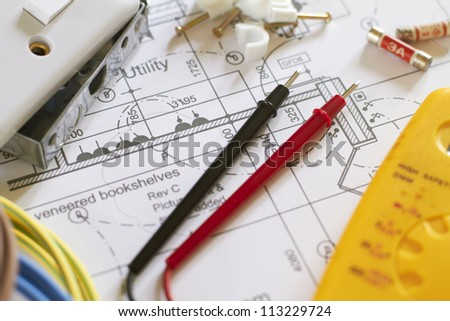Still Life Of Electrical Components Arranged On Plans - stock photo