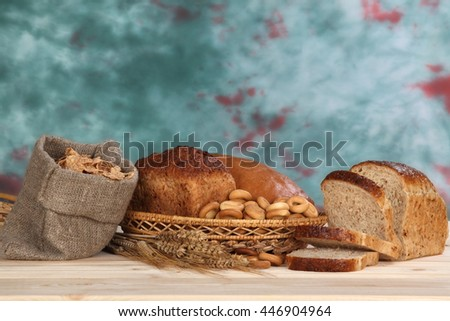 Still life of fresh bread, bagels and cereal - stock photo