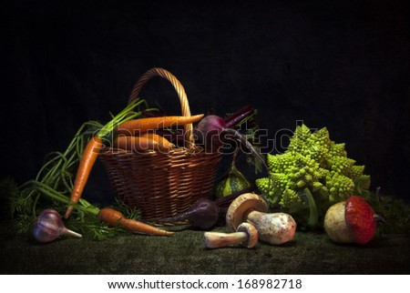 still life of fresh vegetables on a dark background - stock photo