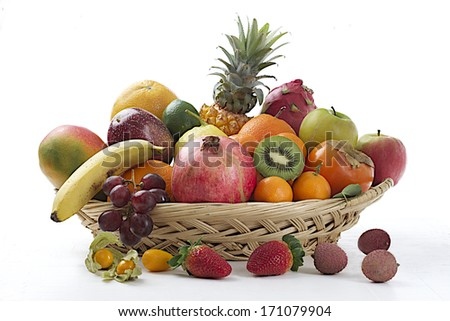 Still life of fruit in basket isolated on white  background - stock photo