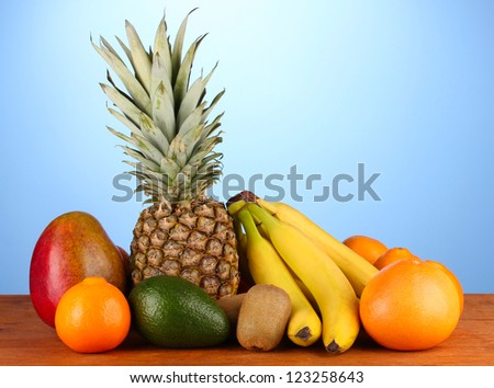 still life of fruit on a table on a blue background