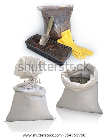 Still life of gardening items isolated on white background. Plastic sac with peat, mixture of earth and fertilizer for seedlings in black container, trowel and yellow rubber gloves for work - stock photo