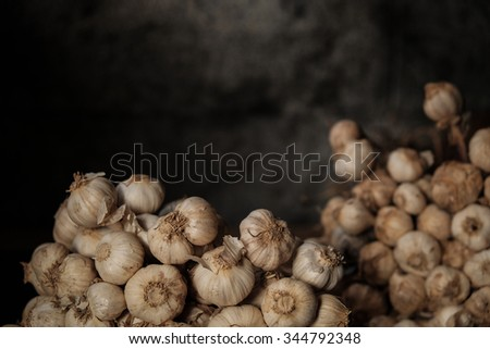 Still Life of Garlic with Dark Background, Moody Natural Lighting, Selective Focus