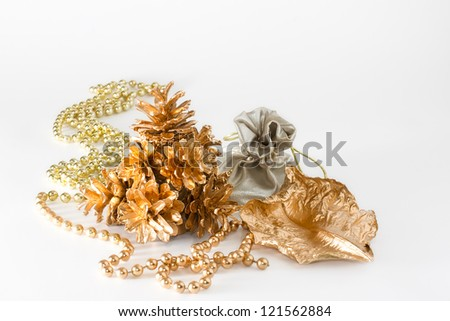 Still life of gold Christmas decorations on a white background