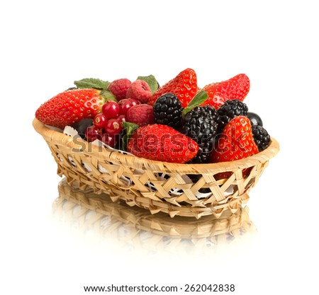 still life of  heap multi-coloured  berrys in  basket, on white background, isolated - stock photo