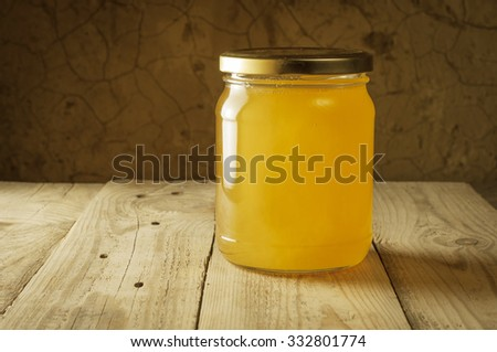 Still life of jars of honey, propolis and pollen