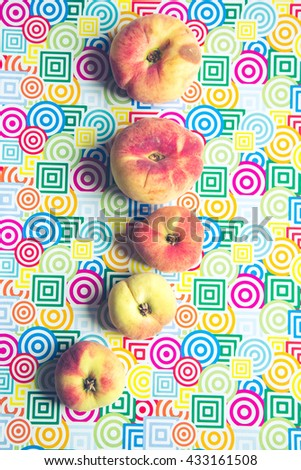 still life of juicy peaches on colored trendy background, healthy summer food concept