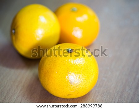 still life of orange on brown floor - stock photo