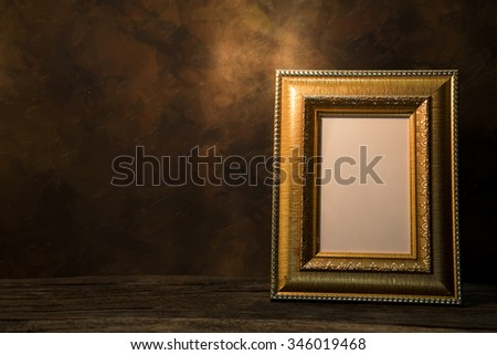 still life of picture frame on table. - stock photo