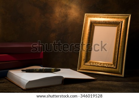 still life of picture frame on table with diary book.