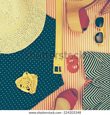 Still Life of Retro Beach Themed Womens Clothing on Striped Background as seen from Above - stock photo