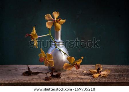 still life of retro vase and orcid - stock photo