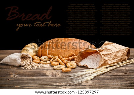 Still life of sliced bread on old wooden table