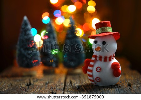 Still life of Snowman with bokeh lights in the background - stock photo