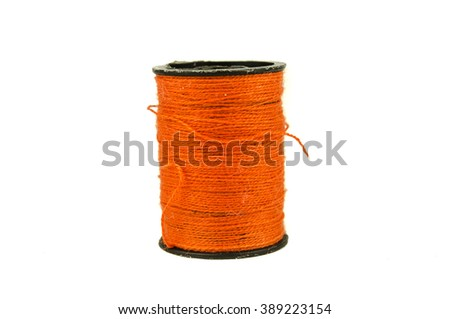 still life of spools of thread on a wooden background / Spool of thread isolated on  white / three different spools of thread on white background / Sewing threads multicolored background closeup - stock photo