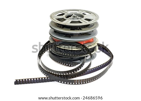still life of stack of dirty, old 8mm cine film and reels; isolated on white ground - stock photo