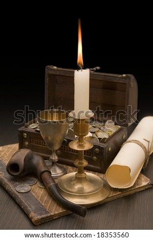 Still life of vintage objects with candle
