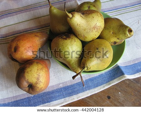 still life of yellow, green pears and grapes on towel.Color photo, rustic style. Ukraine. Photo for backgrounds. - stock photo