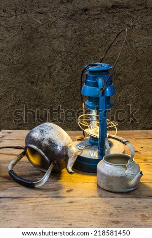 Still life old lamp with old classic kettle - stock photo