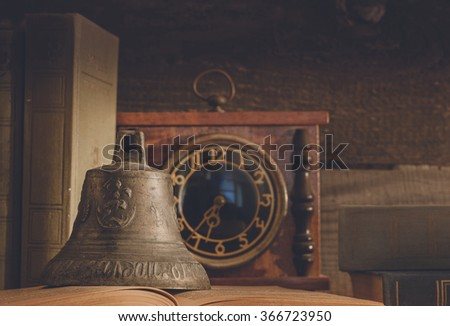 Still Life (old sailor). The photo shows the old books, the layout sailing ship and an old brass bell - stock photo