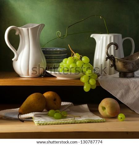 Still life on kitchen shelf over grunge background - stock photo