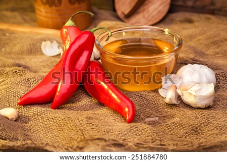 Still life on sackcloth, warm, homemade recipe. To advertise vodka, what would sober up after a hangover. Snack - ramiro sweet pepper, honey and garlic. - stock photo