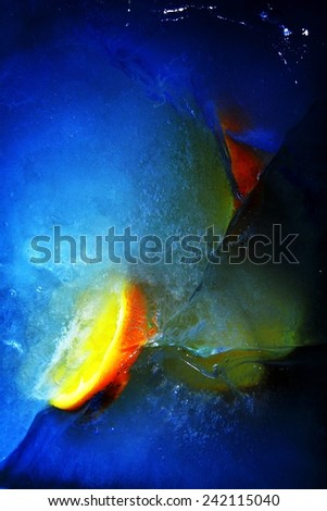 Still life - Orange slices in ice  - stock photo