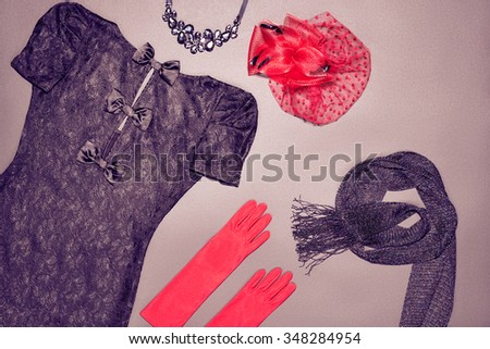 Still life Outfit  Top view. Fashion clothes stylish set, little black lace dress, accessories. Glamor creative, trendy red hat, gloves, necklace, scarf. Unusual elegant evening party. Vintage retro - stock photo