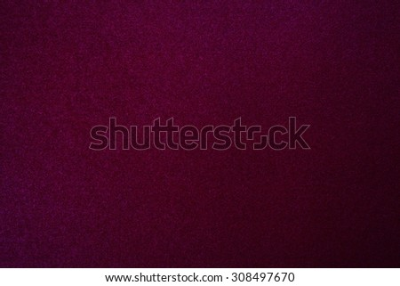 Still life paper texture background with a grain noise effect, full frame. Close up detail of a sheet of paper blank page with intense red dye on organic art paper. Background wall burgundy color. - stock photo