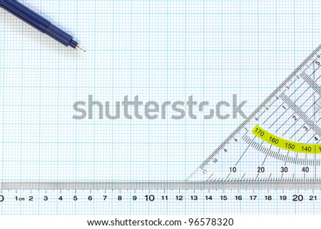Still life photo of engineering graph paper with a fine 0.1mm pen, protractor and ruler blank to add your own design, image or text. - stock photo