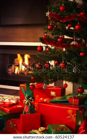 Still life photo of presents and christmas tree in living room.? - stock photo
