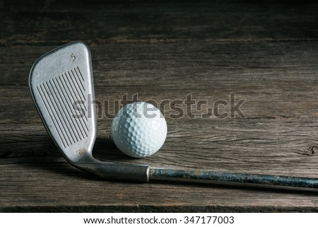 still life photography : golf club and ball on old wood in vintage color tone