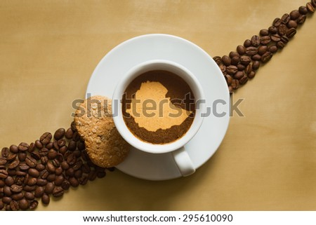 Still life photography of hot coffee beverage with map of Ethiopia - stock photo