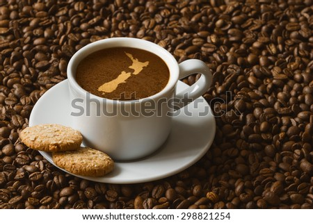 Still life photography of hot coffee beverage with map of New Zealand
