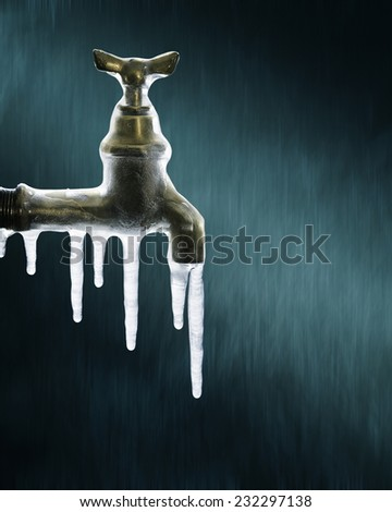 Still life photography of icicles on the water tap - stock photo